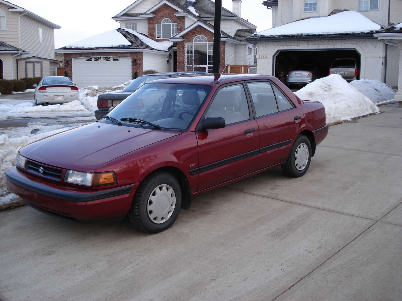 1992 Mazda Protege Red | 200  Interior and Exterior Images