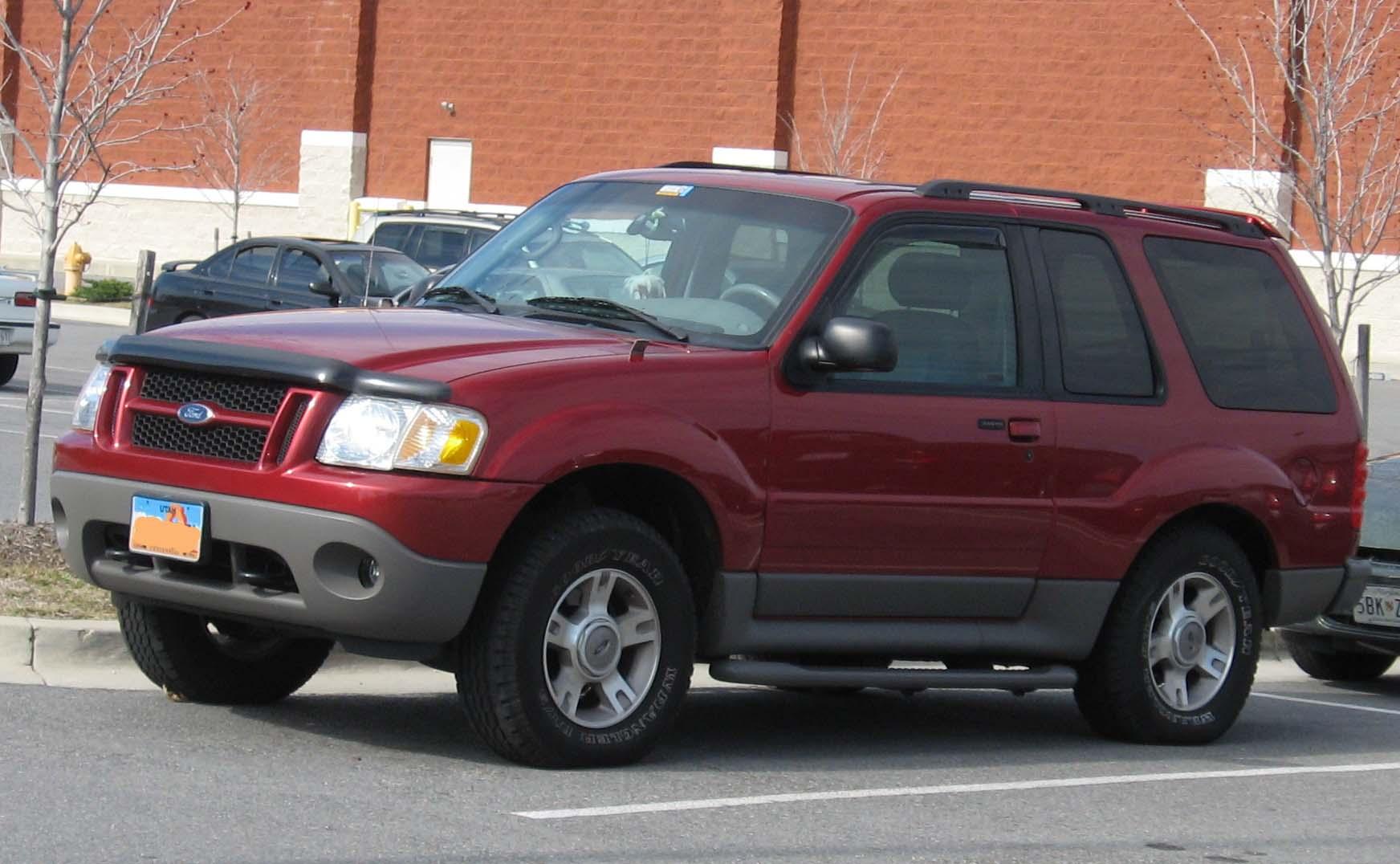 Red 2002 ford explorer sport