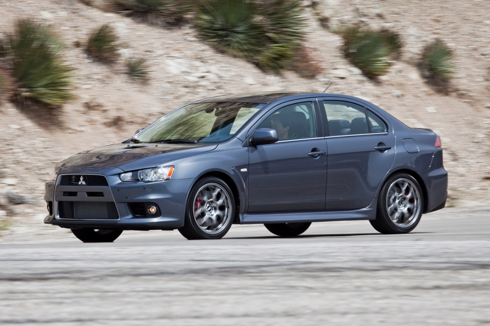 above evolution mitsubishi drivers updated news lancer motor trend for side year sale its last mr